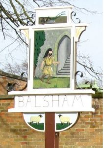 Old village sign, depicting the one resident of Balsham who escaped the Viking invasion in 1018.